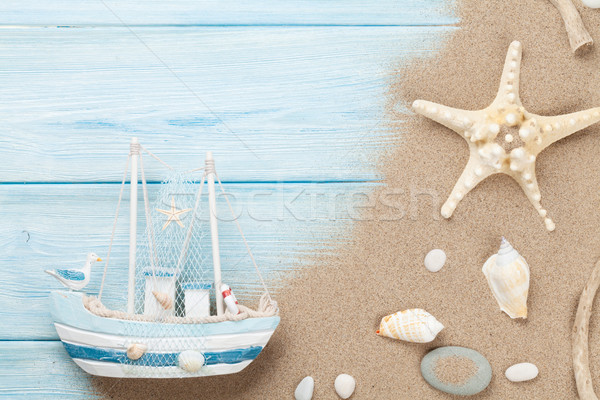 Travel and vacation background with items over sand Stock photo © karandaev