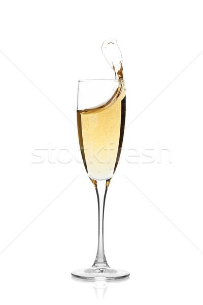 Champagne glass with splash Stock photo © karandaev