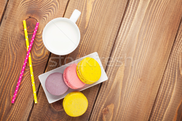 Colorful macaron cookies and cup of milk Stock photo © karandaev