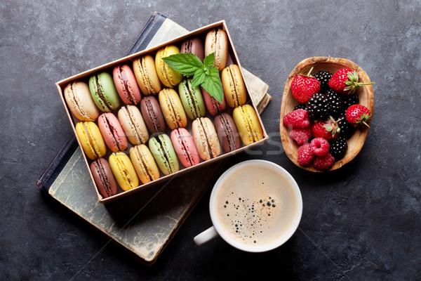 Colorful macaroons, berries and coffee Stock photo © karandaev