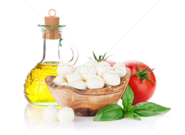 Foto stock: Mozzarella · queso · aceite · de · oliva · tomate · albahaca · hierba