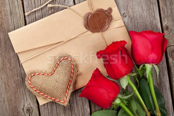 Love letter, red roses and heart Stock photo © karandaev