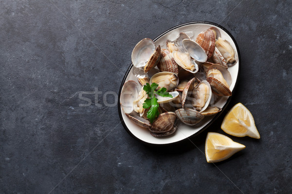 Fresh seafood bowl on stone table. Scallops Stock photo © karandaev