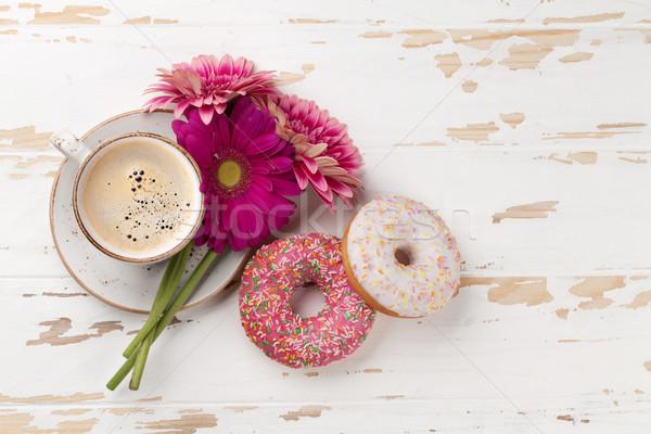 Tazza di caffè fiori bianco tavolo in legno top Foto d'archivio © karandaev