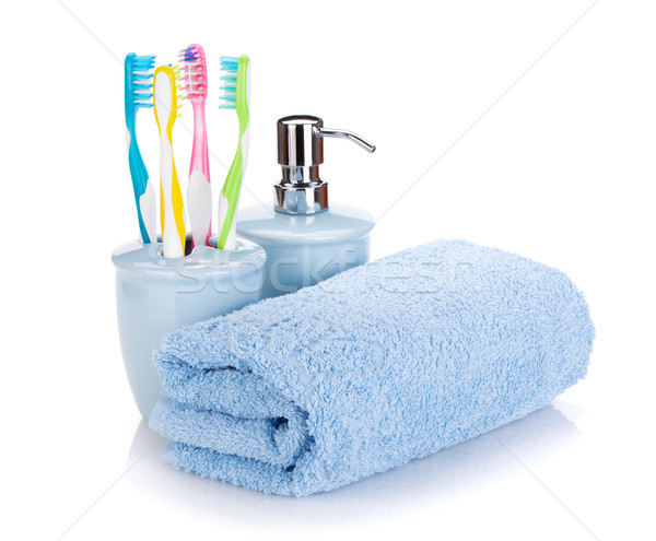Four colorful toothbrushes, liquid soap and towel Stock photo © karandaev