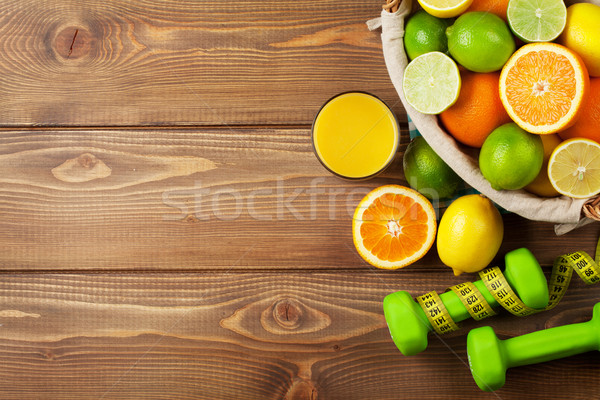 Citrus fruits in basket and dumbells. Oranges, limes and lemons Stock photo © karandaev