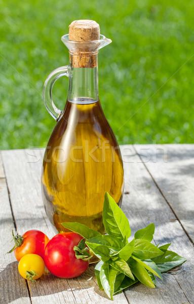 Zeytinyağı şişe biber shaker domates otlar Stok fotoğraf © karandaev