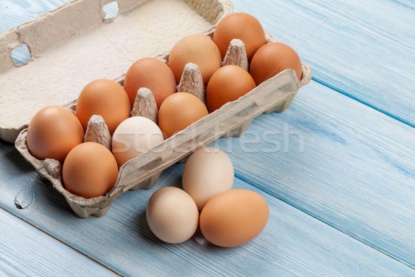 Cardboard egg box on wooden table Stock photo © karandaev