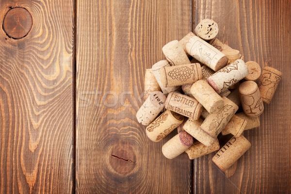 Wine corks heap over rustic wooden table background Stock photo © karandaev