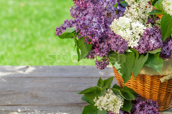 Colorful lilac flowers in basket Stock photo © karandaev