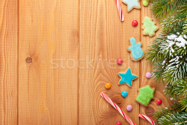Christmas wooden background with snow fir tree, gingerbread cook Stock photo © karandaev