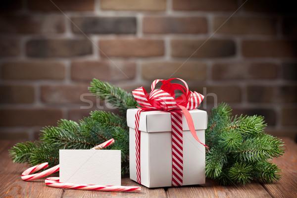 Karácsony ajándék doboz üdvözlőlap fenyőfa ág fa asztal Stock fotó © karandaev