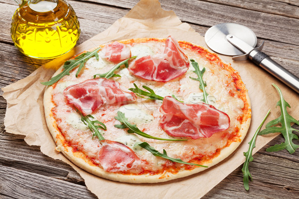 Pizza with prosciutto and mozzarella Stock photo © karandaev