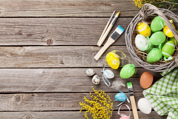 Colorido huevos de Pascua mesa de madera superior vista espacio de la copia Foto stock © karandaev