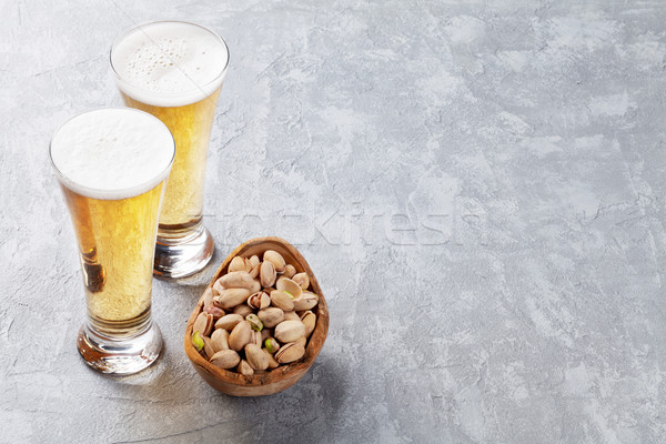 Lager beer glasses and pistachio nuts Stock photo © karandaev