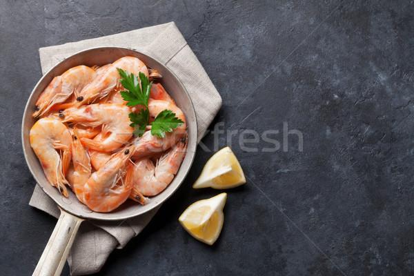 Fresh seafood on stone table. Shrimps Stock photo © karandaev