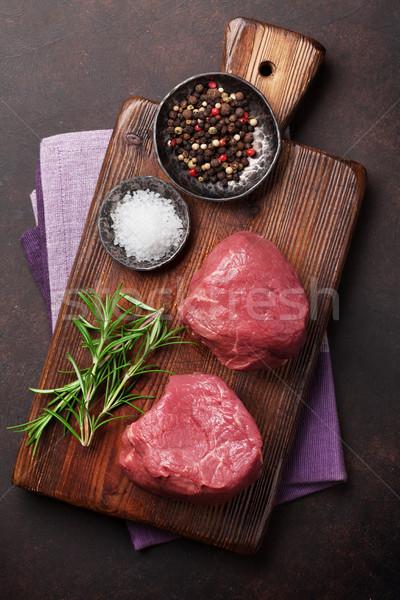 Nyers filé steak főzés kő asztal Stock fotó © karandaev