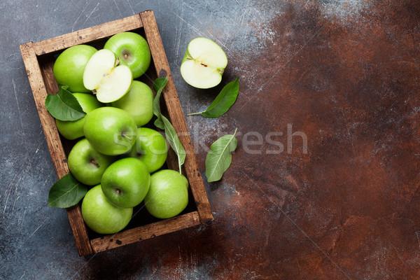 Green apples in wooden box Stock photo © karandaev