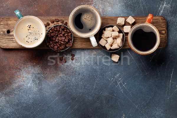 Coffee cups, beans and brown sugar Stock photo © karandaev