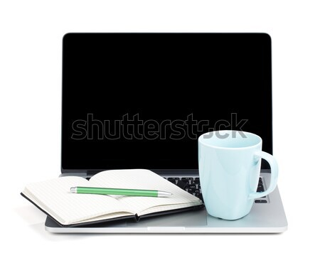 Tea cup and office supplies on laptop Stock photo © karandaev