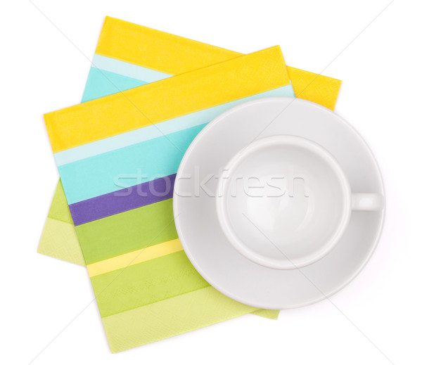 Empty white cup on placemat Stock photo © karandaev