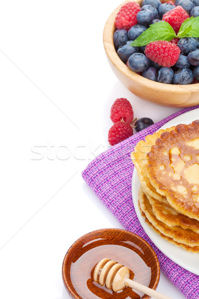 Pancakes with raspberry, blueberry, mint and honey syrup Stock photo © karandaev