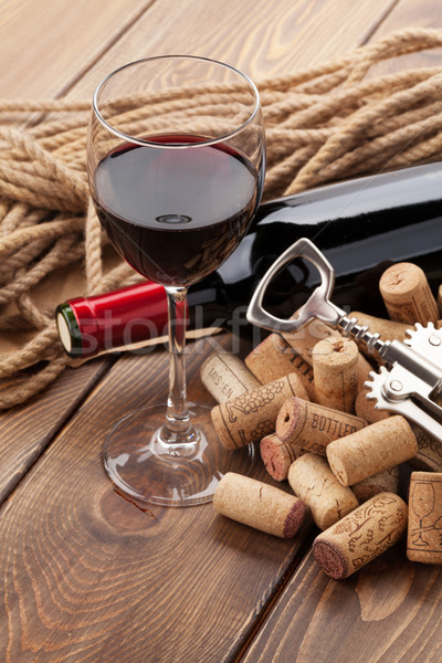 Glass of red wine, bottle and corkscrew Stock photo © karandaev