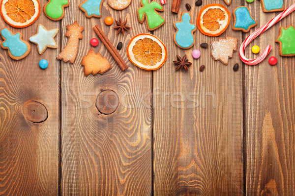 Christmas wooden background with candies, spices, gingerbread co Stock photo © karandaev