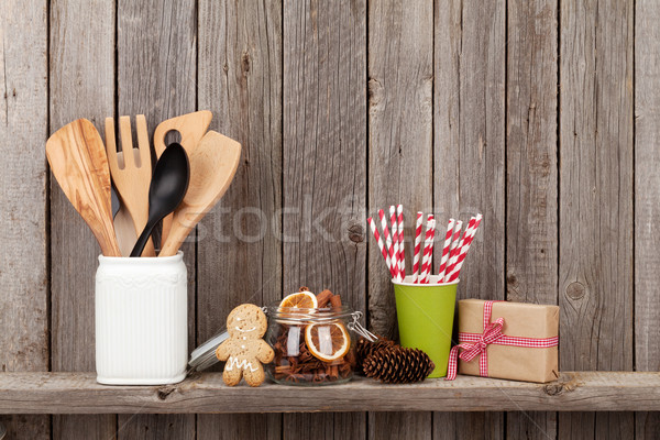 Stock photo: Kitchen utensils and christmas spices on shelf