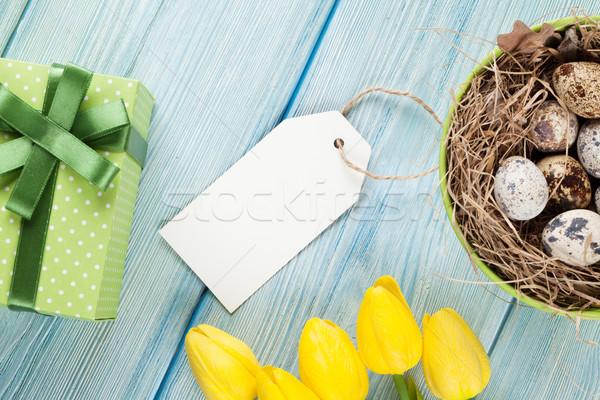 Easter with eggs and yellow tulips Stock photo © karandaev