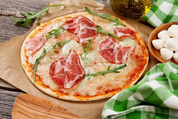Pizza prosciutto mozzarella fa asztal vacsora saláta Stock fotó © karandaev
