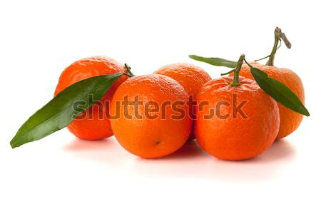 Five ripe tangerines Stock photo © karandaev