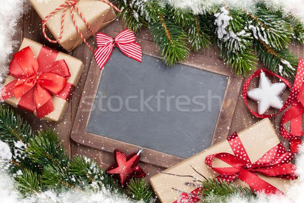 Karácsony tábla ajándékdobozok dekoráció fenyő fenyőfa Stock fotó © karandaev