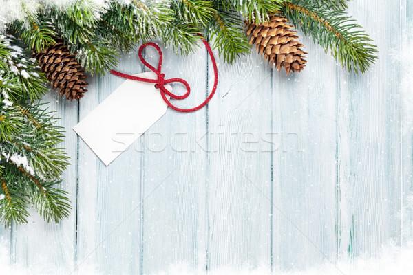 Christmas background with gift label Stock photo © karandaev
