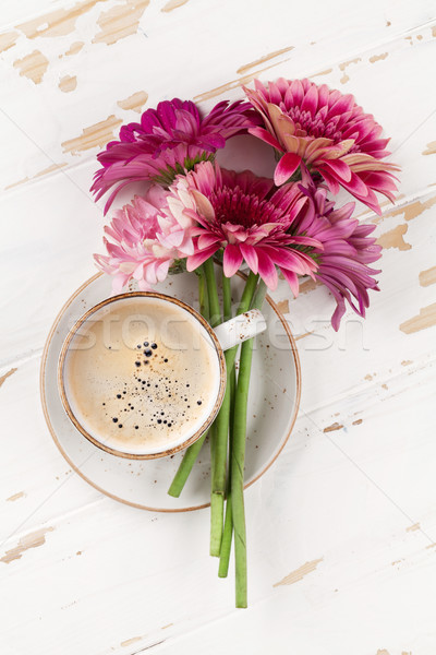 Gerbera flowers bouquet and coffee cup Stock photo © karandaev
