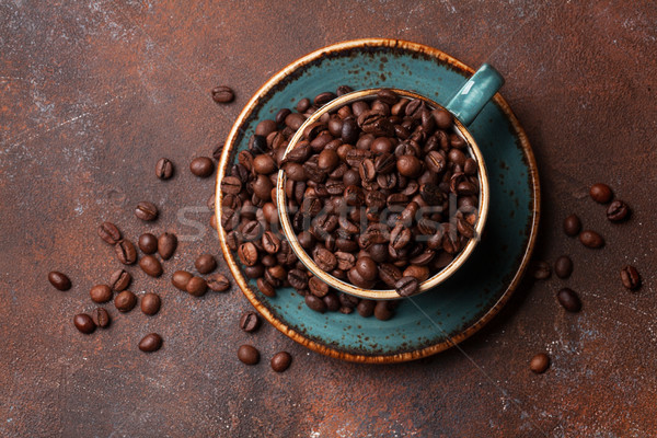Coffee cup with roasted beans Stock photo © karandaev