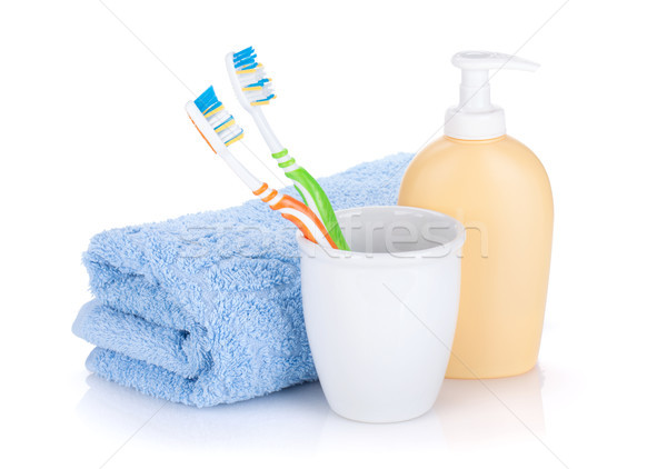 Two colorful toothbrushes, liquid soap and towel Stock photo © karandaev