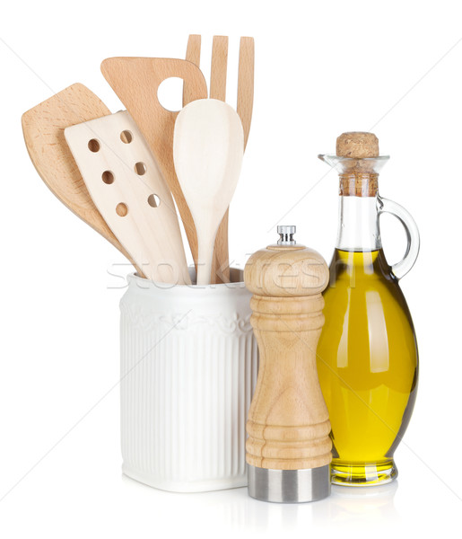 Kitchen utensils in holder and condiments Stock photo © karandaev