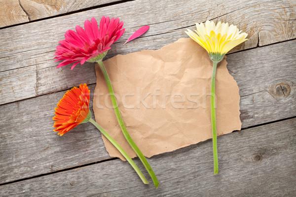 Сток-фото: три · красочный · цветы · бумаги · копия · пространства · деревянный · стол