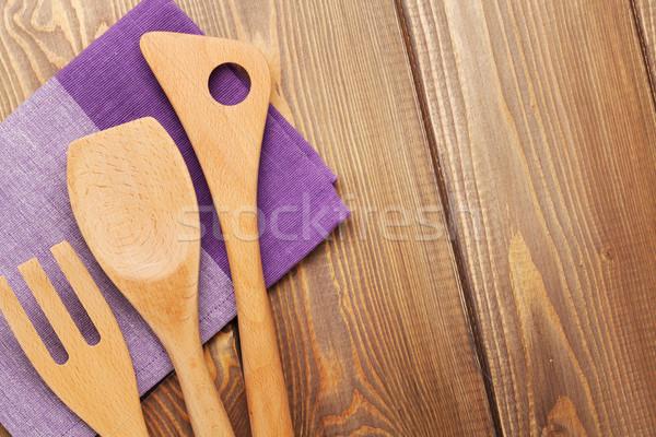 Wood kitchen utensils over wooden table background Stock photo © karandaev