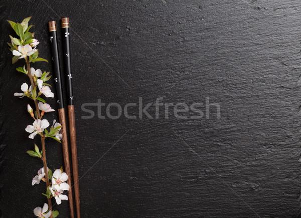 Japonés sushi palillos sakura flor negro Foto stock © karandaev