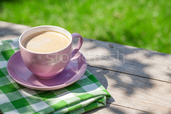 Coffee cup on garden table Stock photo © karandaev