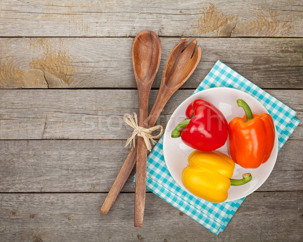 Stock photo: Colorful bell peppers and kitchen utensils