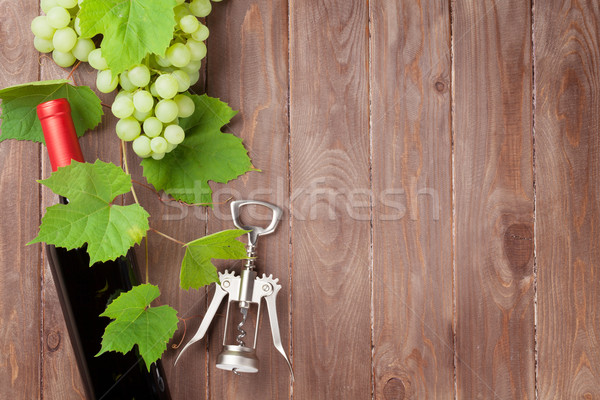 Bunch of grapes, red wine bottle and corkscrew Stock photo © karandaev