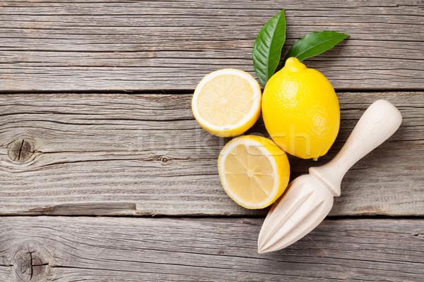 Fresh lemons and juicer Stock photo © karandaev