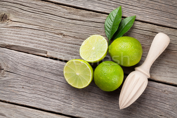 Fresh limes and juicer Stock photo © karandaev