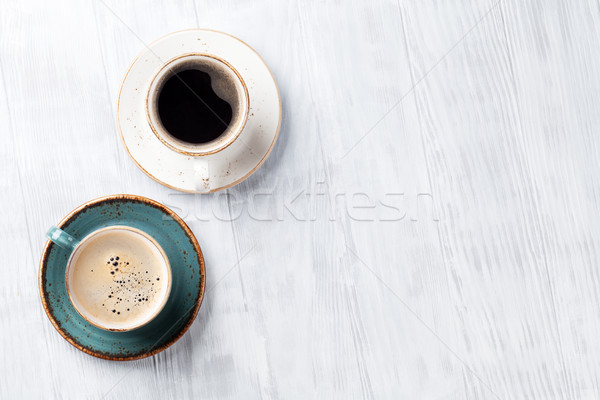Coffee cups on wooden kitchen table Stock photo © karandaev