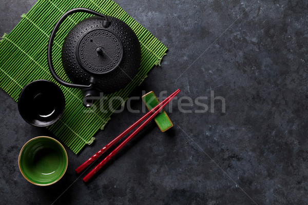 Green tea and sushi chopsticks Stock photo © karandaev