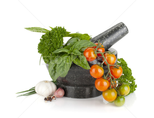 Fresh herbs and spices in mortar Stock photo © karandaev