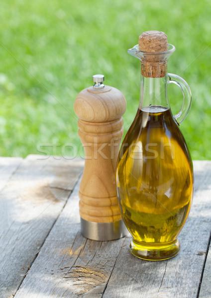 Olívaolaj üveg bors shaker fa asztal fa Stock fotó © karandaev